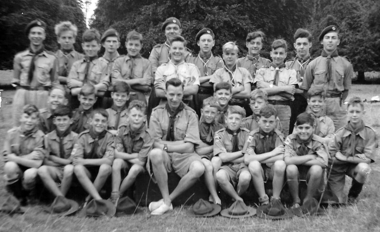 3 rows of boys and men wearing Scout uniform