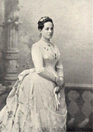 a lady wearing a white gown with a large bustle