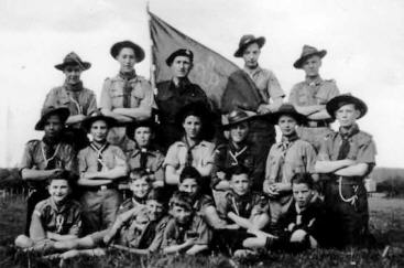a group of Boy Scouts some wearing wide brimmed hats